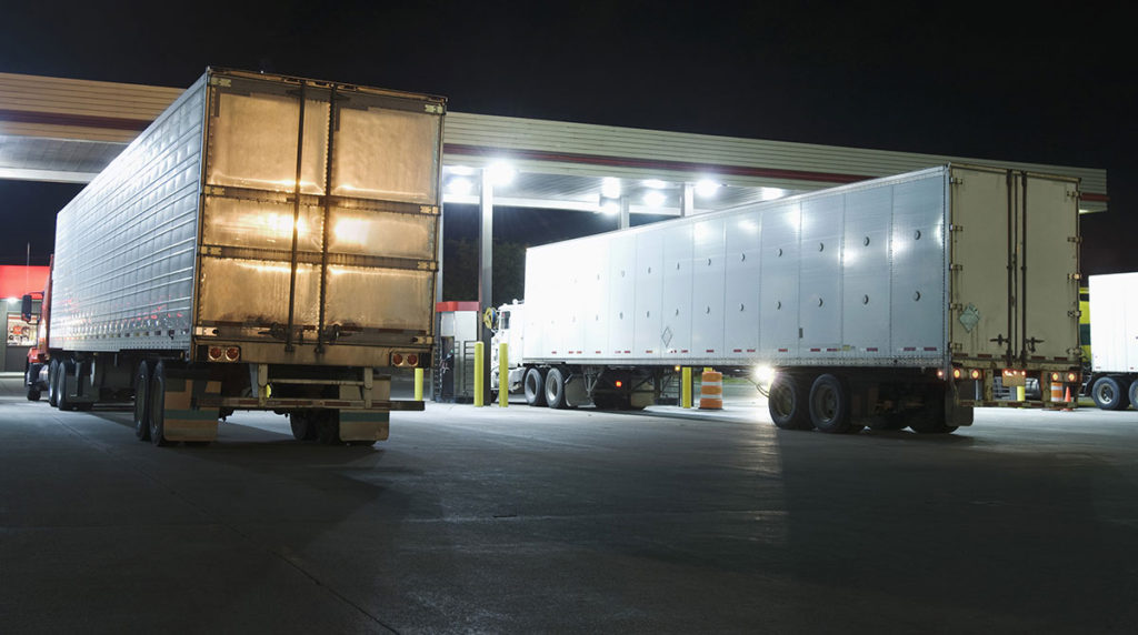 diesel-truck-stop-trailers-thinkstock-night_3